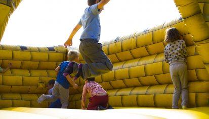 Kids jumping on castle