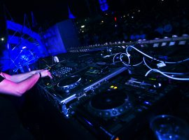 DJ Playing Music in Live Concert Festival